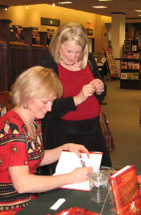 Signing Pam's copy of my debut novel in Omaha